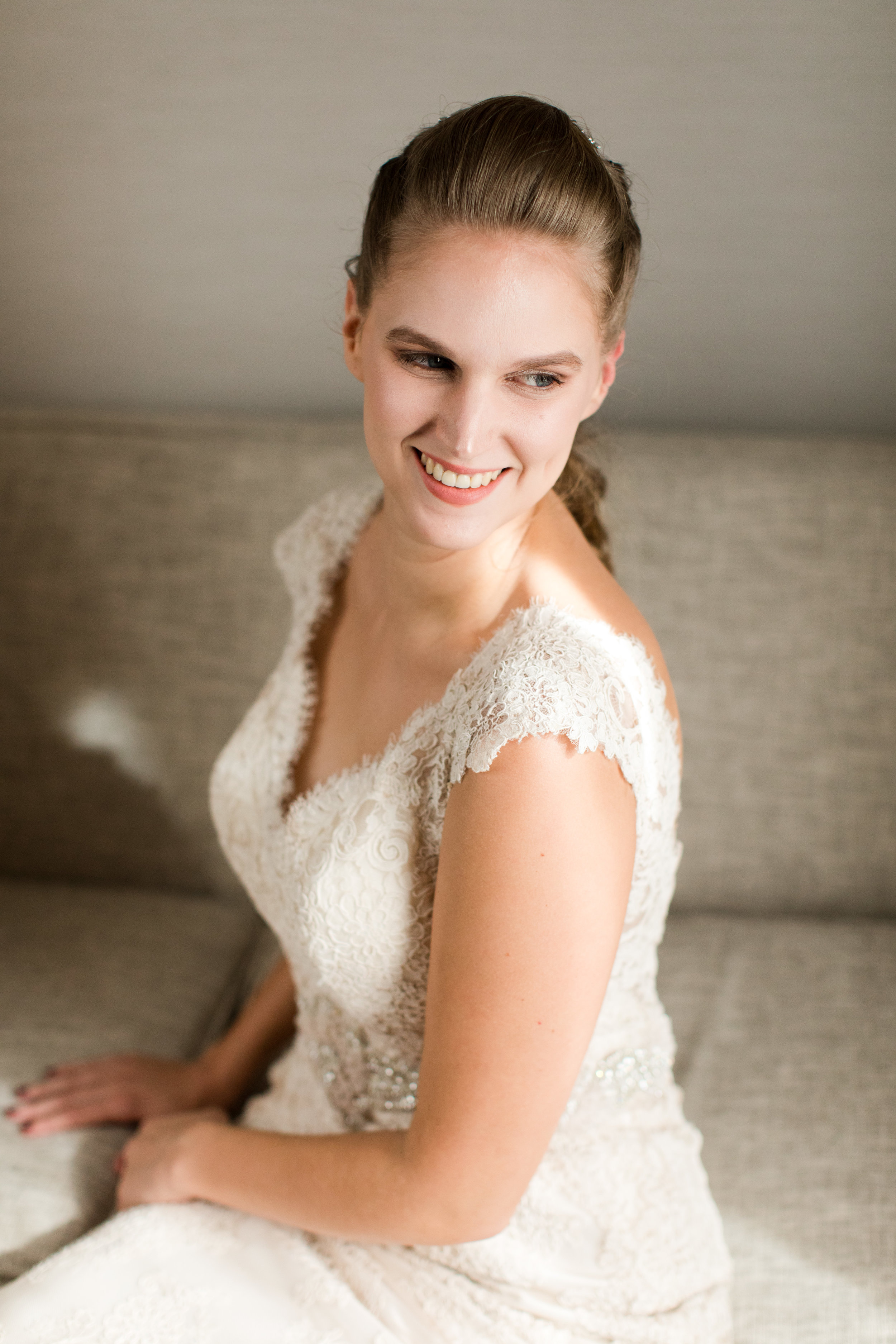bride in all lace dress with braided updo