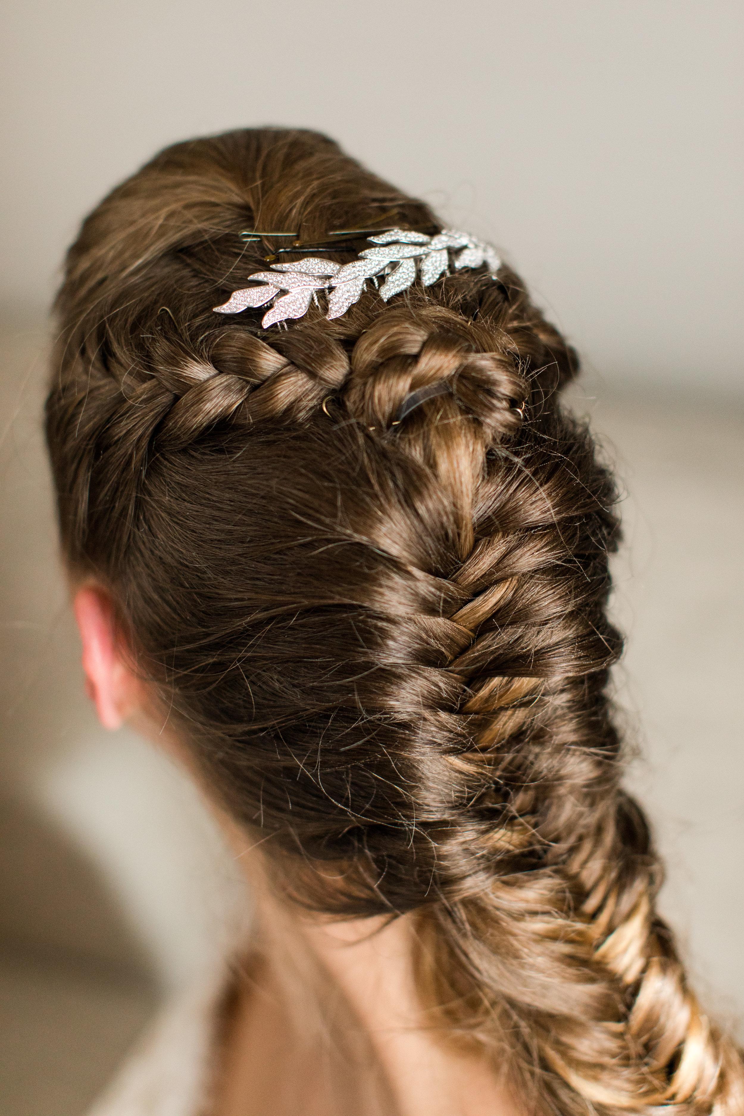 braided bridal hair with rhinestone detail