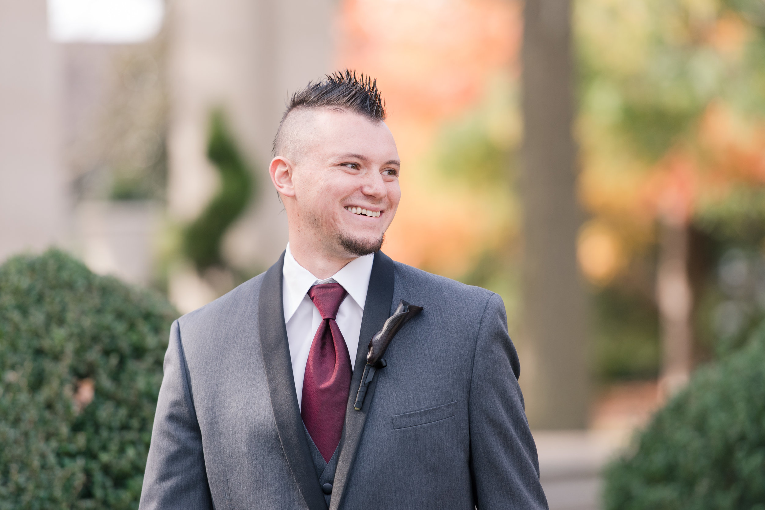 Groom seeing bride for first time during first look at Monmouth University