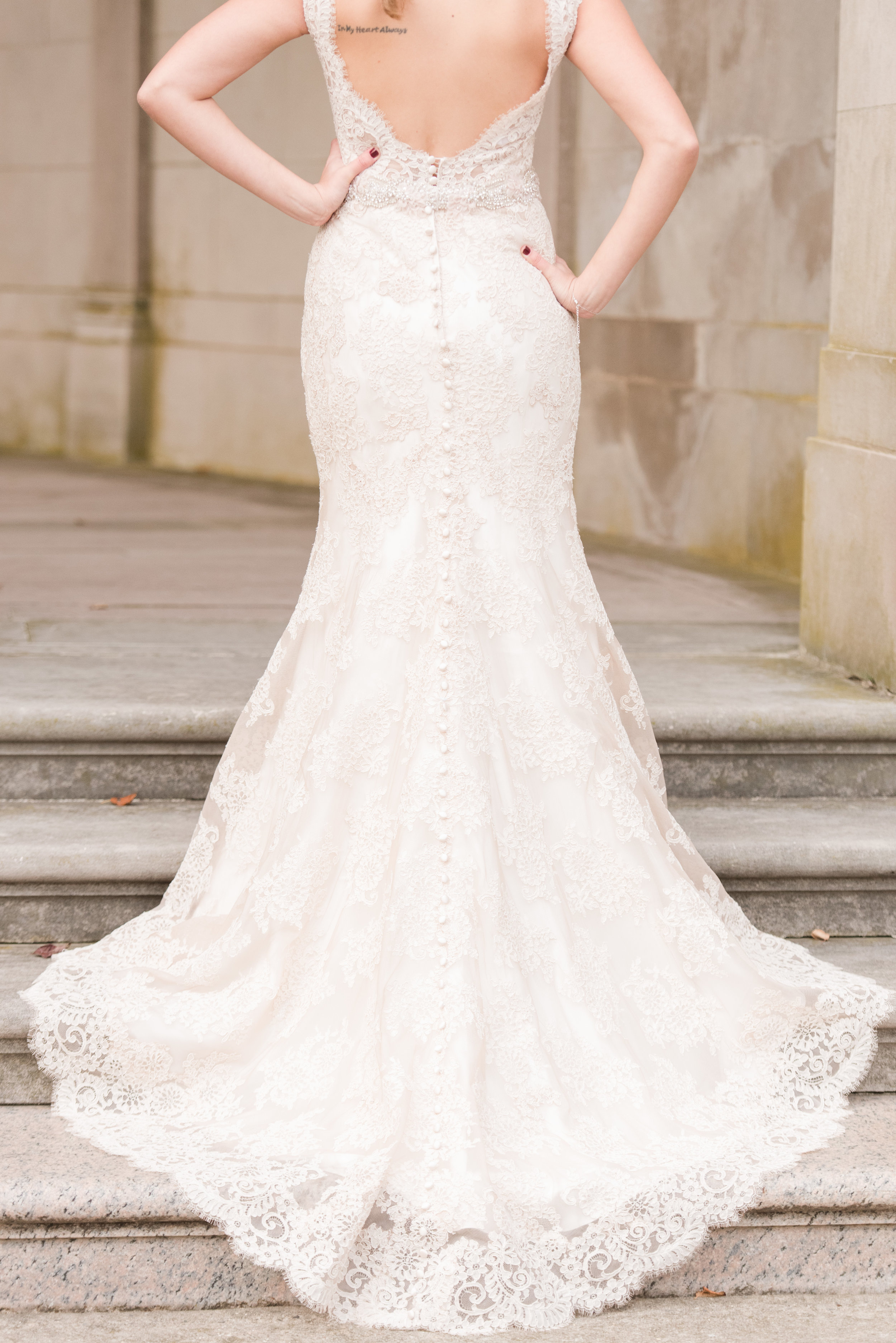 Allure bridal lace wedding dress with low back and buttons down the back