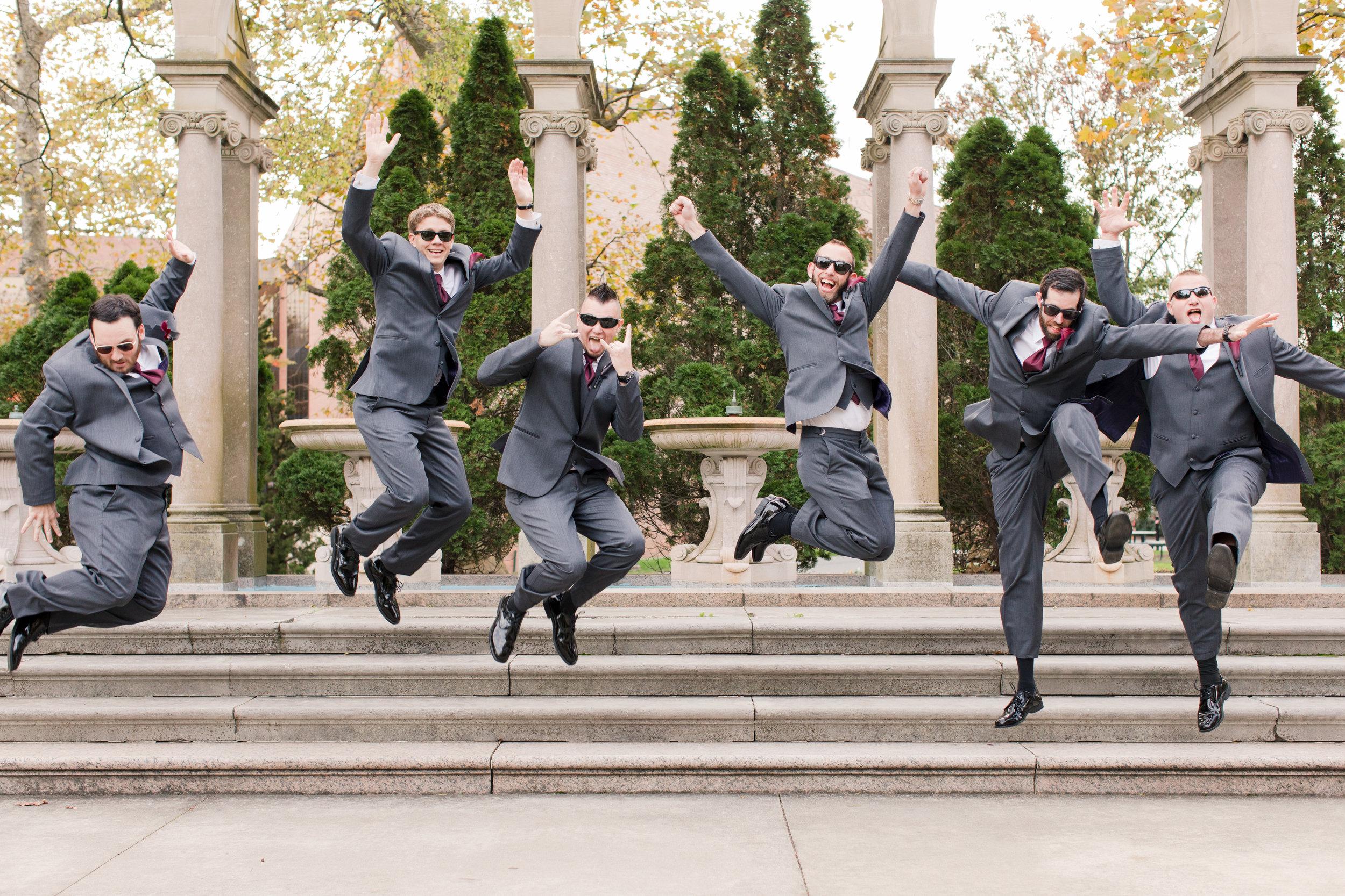 Groomsmen jump for photo at Monmouth University
