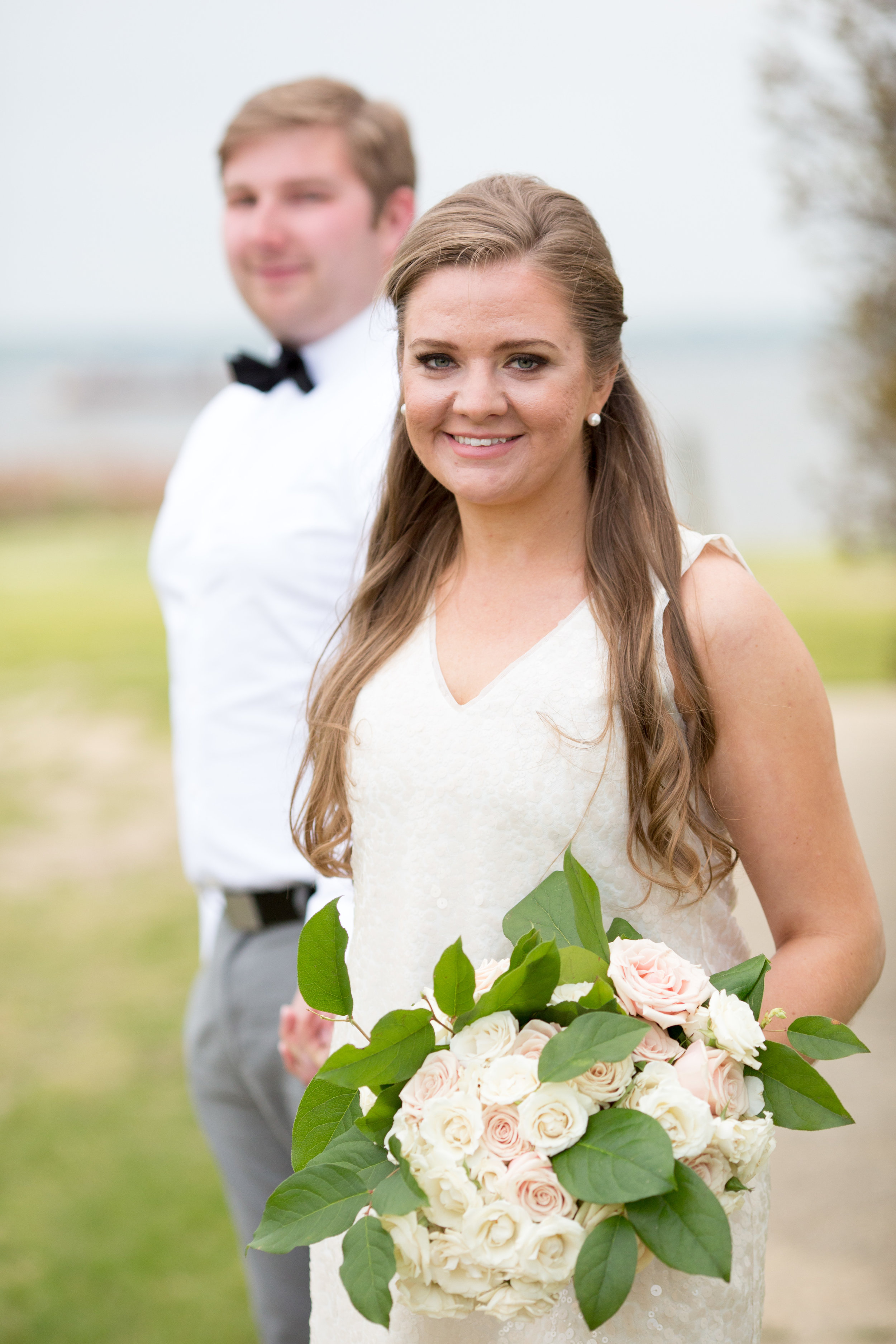 Blush and ivory rose bouquet with greens for beach engagement or beach wedding at sandy hook beach engagement shoot
