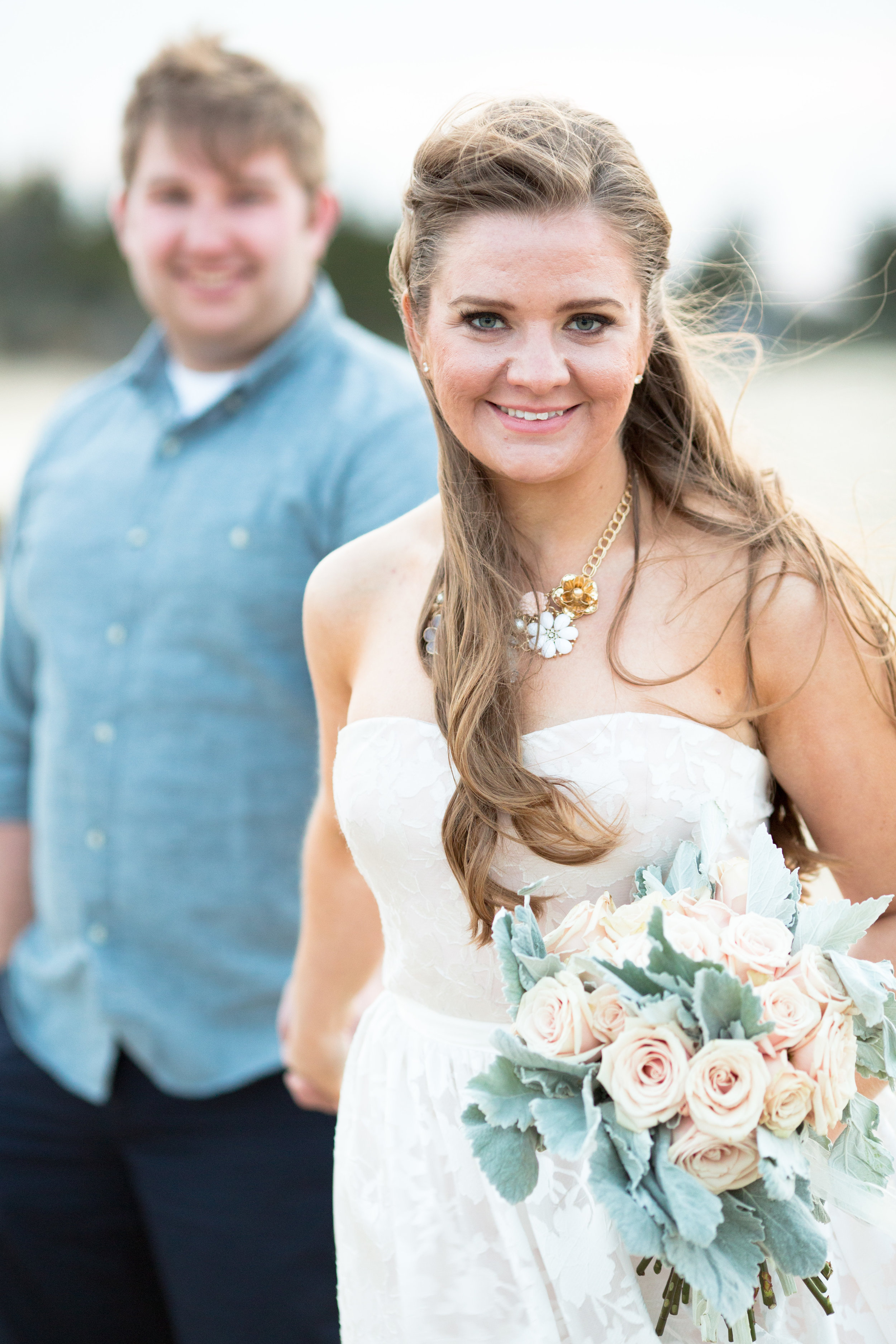 beach engagement photo shoot with blush rose bouquet