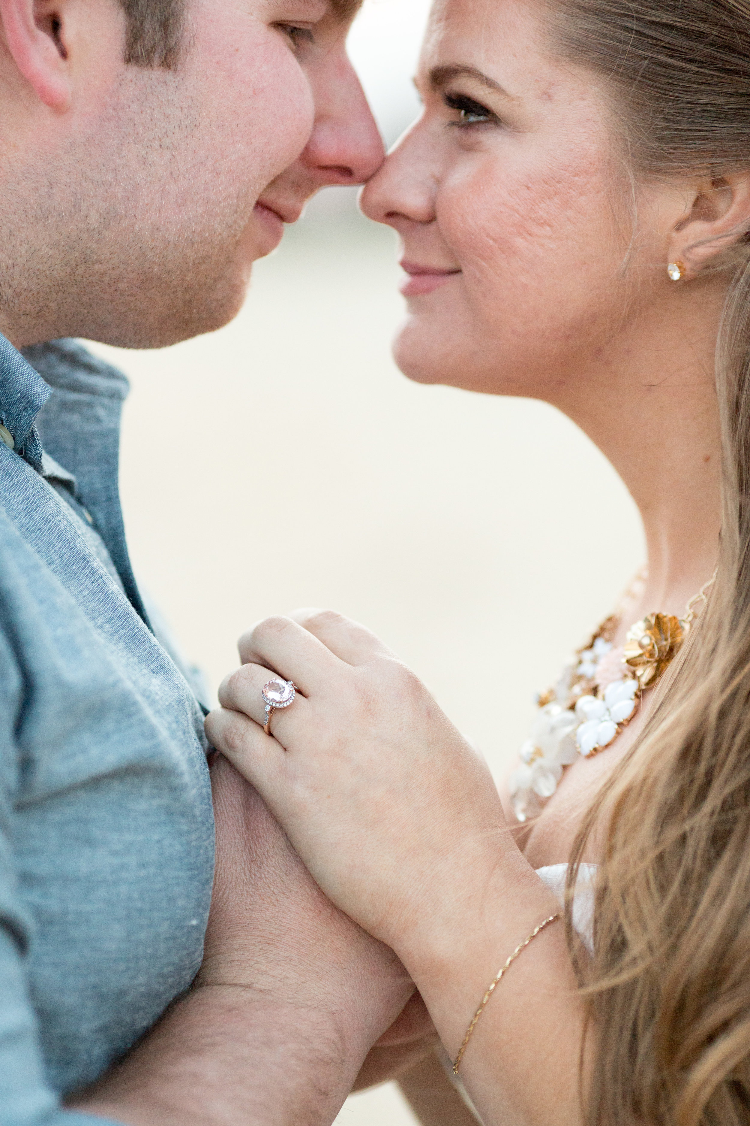 blush pink oval engagement ring at beach engagement photo shoot with jaye kogut photography