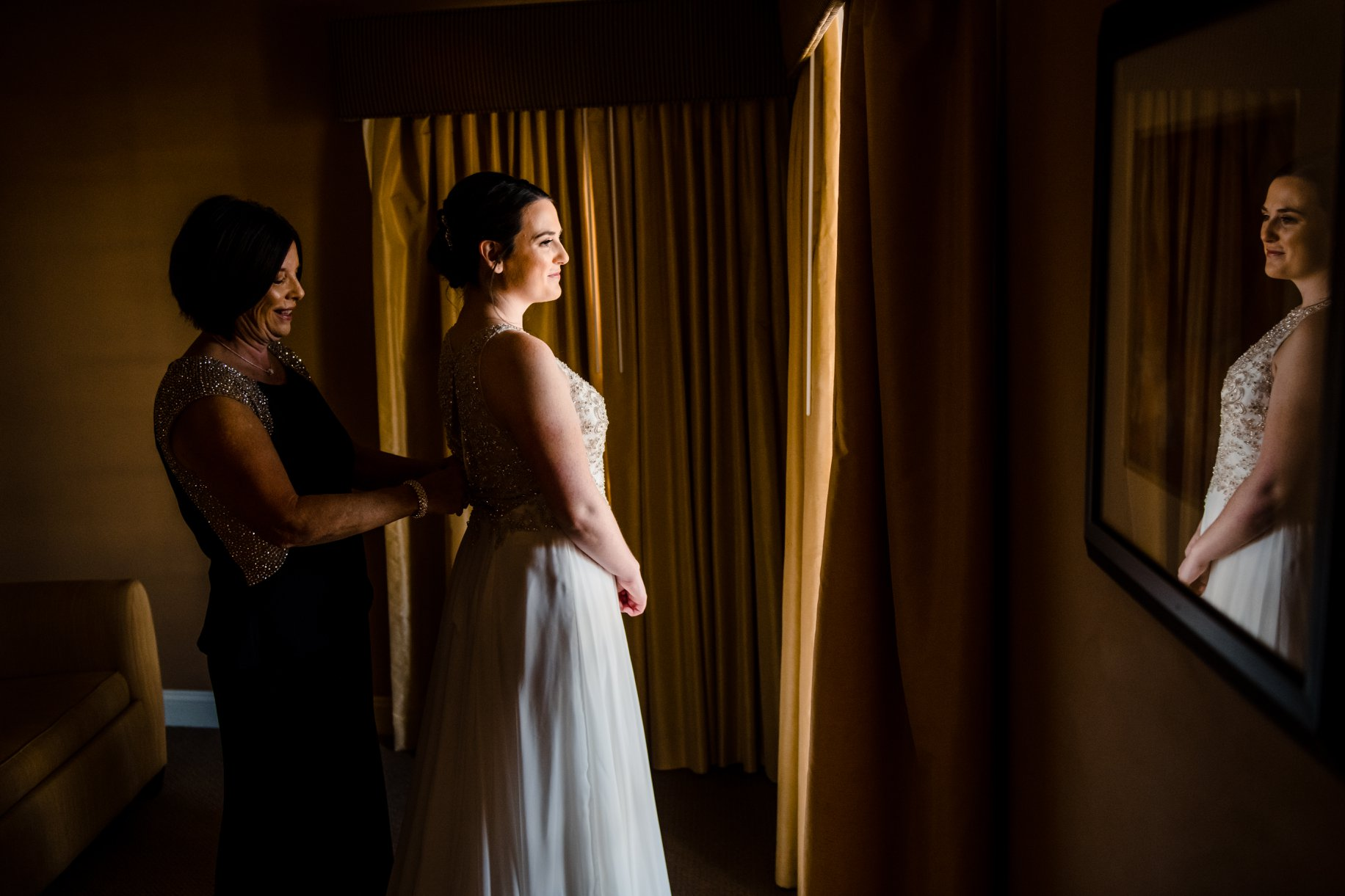 maggie sottero bride in beaded flowy wedding dress at modern traditional american hotel wedding