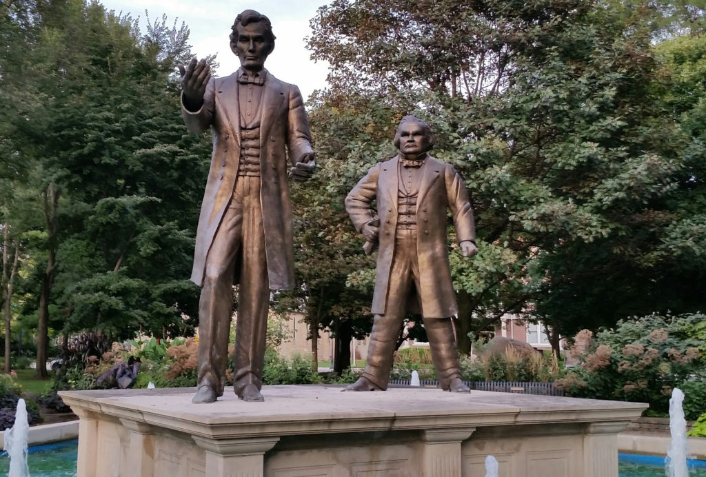 Statues of Abraham lincoln and stephen douglas in the town square of ottawa, illinois