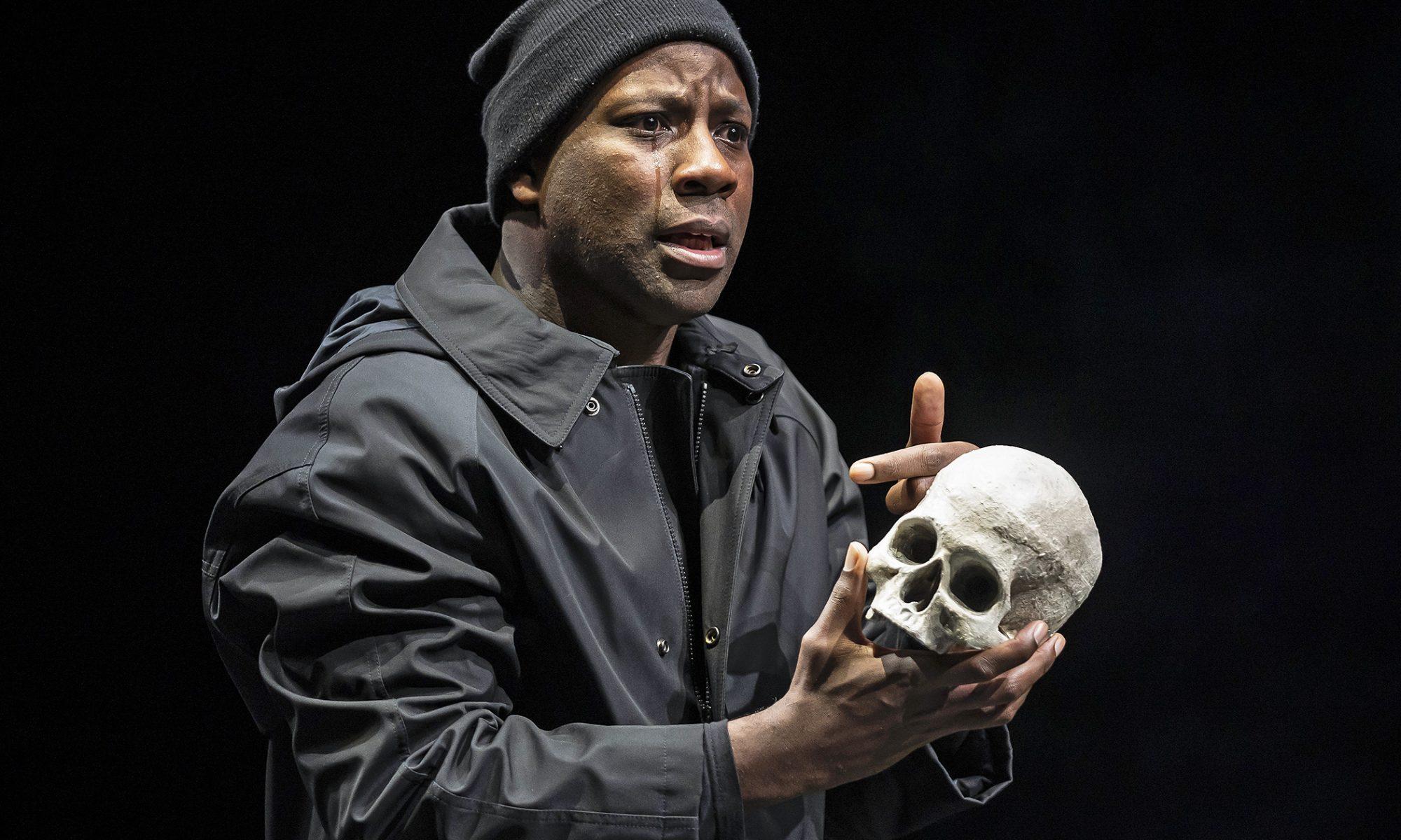 "Maurice Jones, seen here with ""dear Yorick,"" is Hamlet, prince of Denmark."
