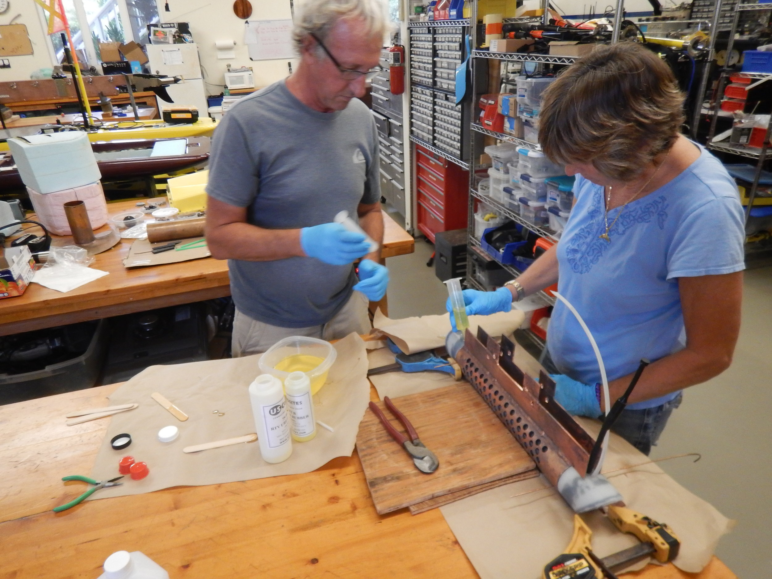 Image 4. Murray and Beth building hydrophone casing