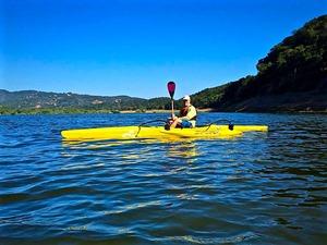 Tim-enjoying-his-outrigger canoe.jpg