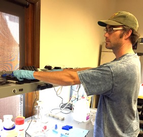 Evan-doing-his-magic-in-the-biology-lab.jpg
