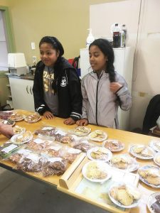 Young Vinnies Miriam Norati and Karote Nawere sell baking at the Levin SVdP pop-up store.