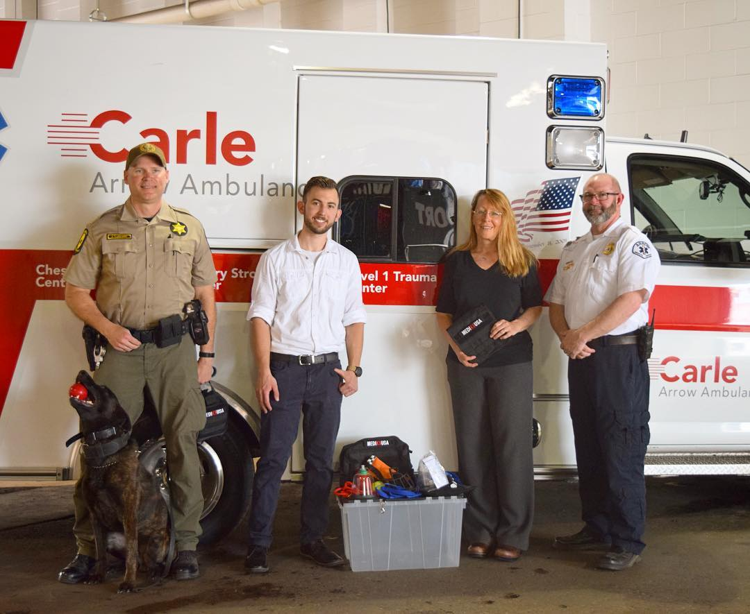 5/2/18 -  Sgt. Lillard and K9 Yadi, Illinois State Police (left), Paul Fedyniak DVM (middle left), Maureen McMichael, DVM (center right), Jim Zinders, operations manager of Arrow Ambulance - Carle Hospital (right).
