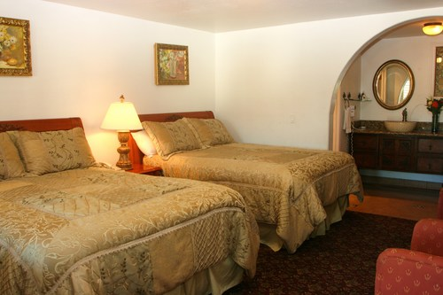 TWO QUEEN BEDS  Features vary: Second floor access with views of mountains and patio.