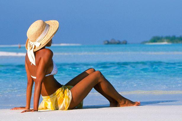 Woman-Sitting-on-Beach.jpg