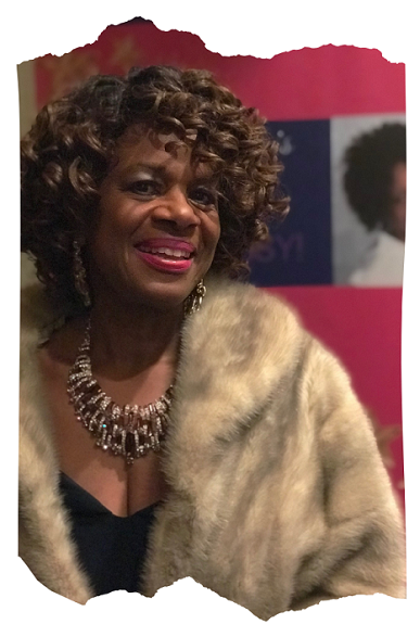 Coach Carmin in mink stole and beautiful necklace.