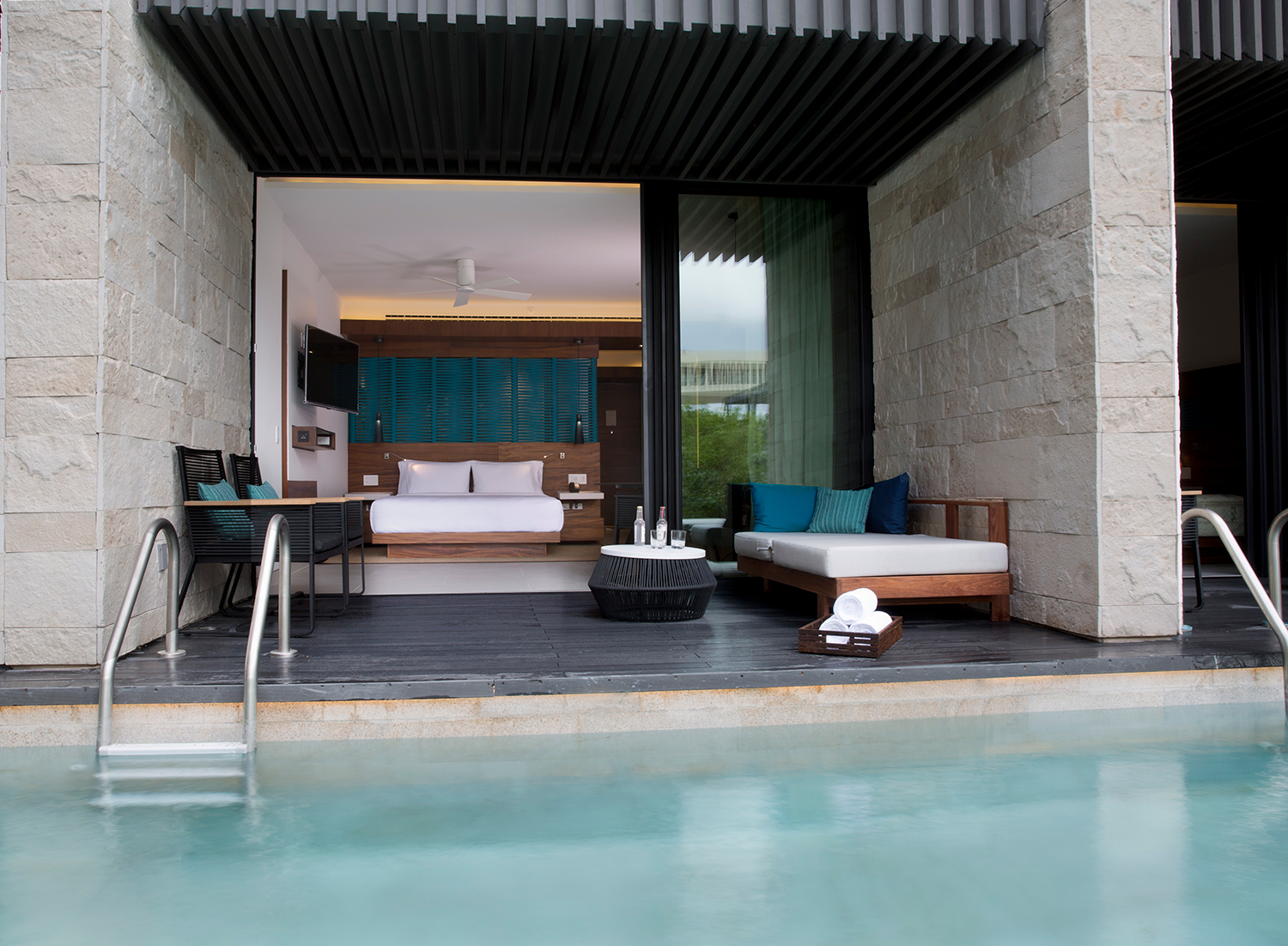 Relaxation area by the pool at Cenote Spa.