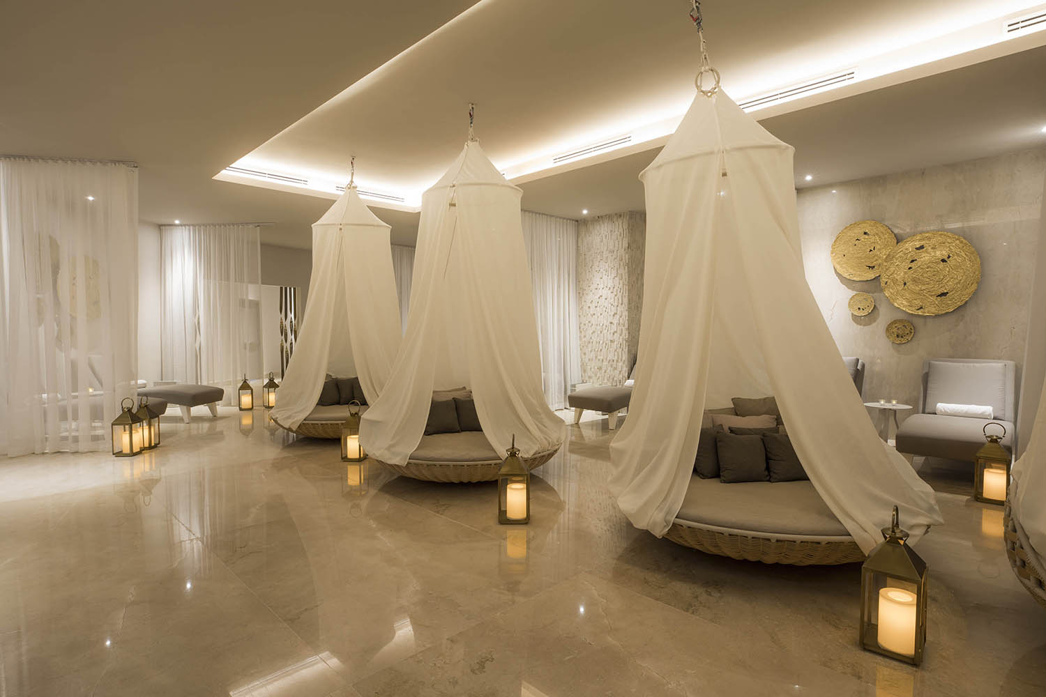 Stylish lounging beds in the spa's waiting area.
