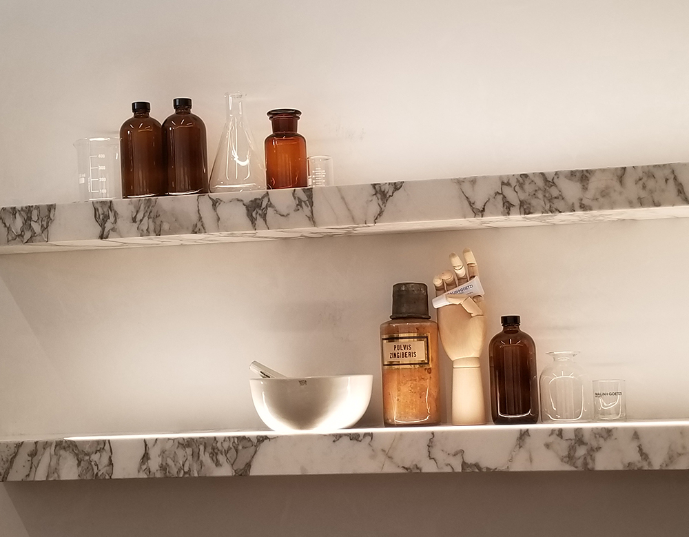 The decor at Malin & Goetz nods to the brand's apothecary roots.