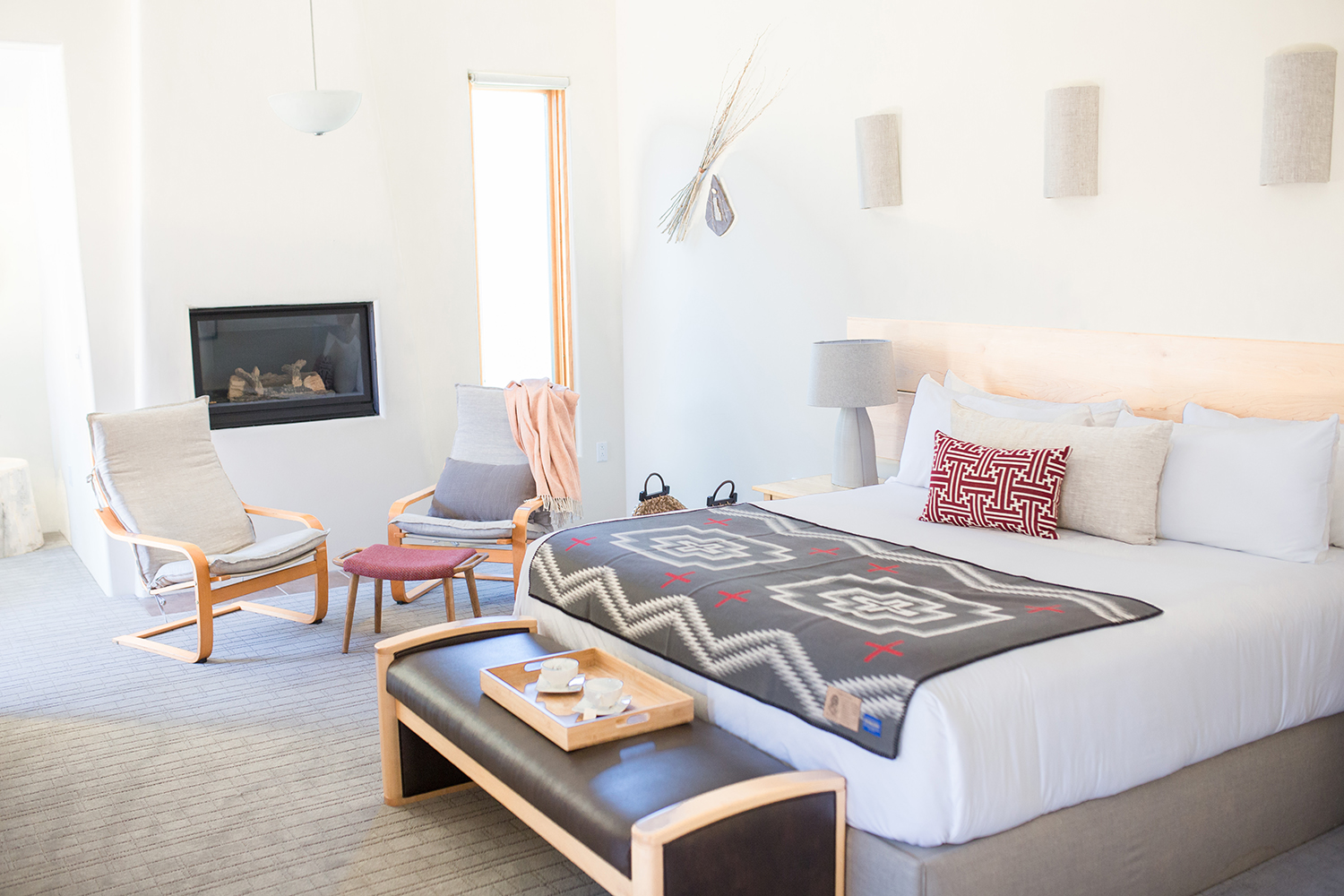 The enchanting accommodations features local artisan touches and a gas fireplace.