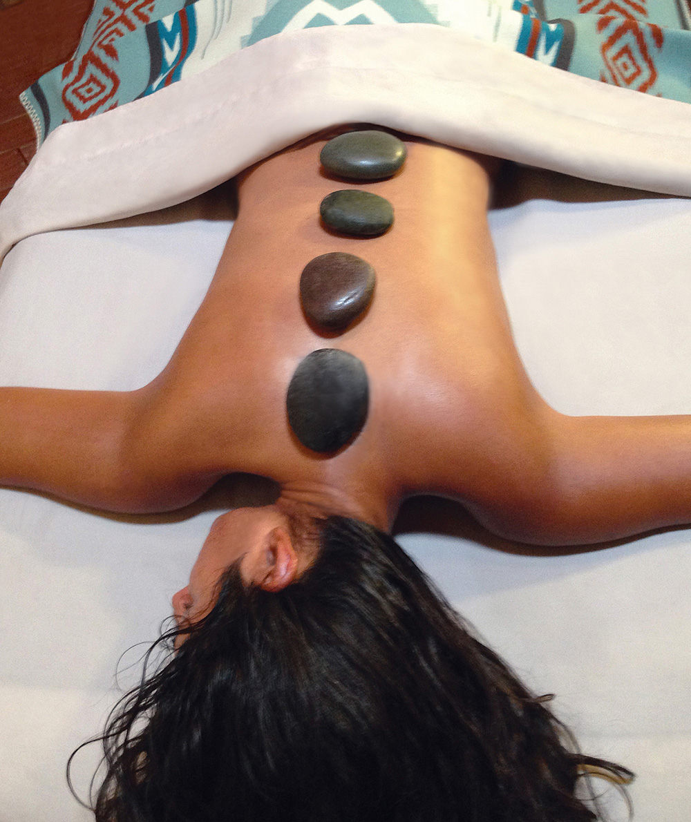 The Earth Keepers' Hot Stone Massage incorporates warm, oiled basalt stones to soothe tired muscles.