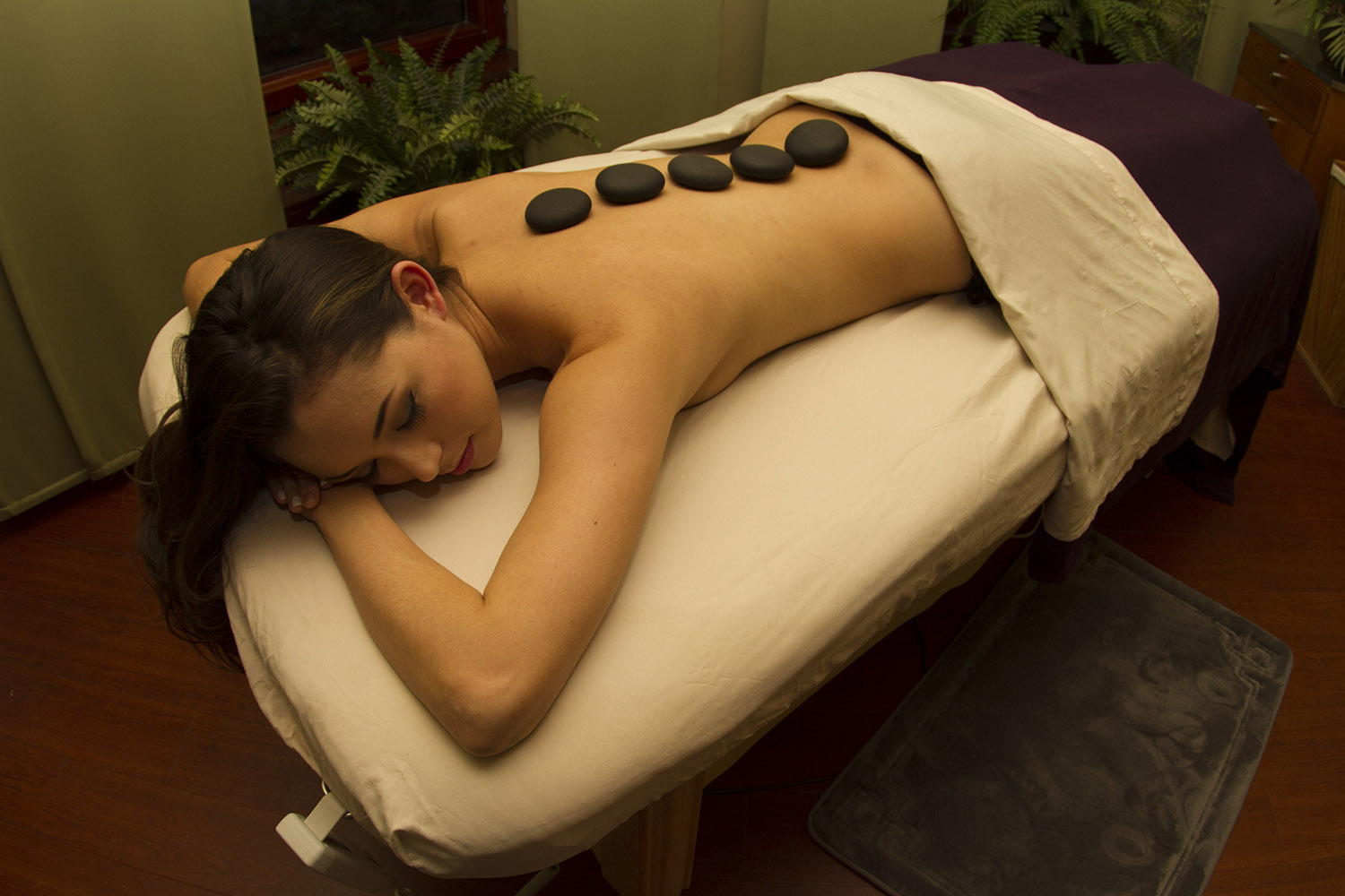 The spa offers a variety of healing treatments, including an 80-minute Hot Stone Massage.