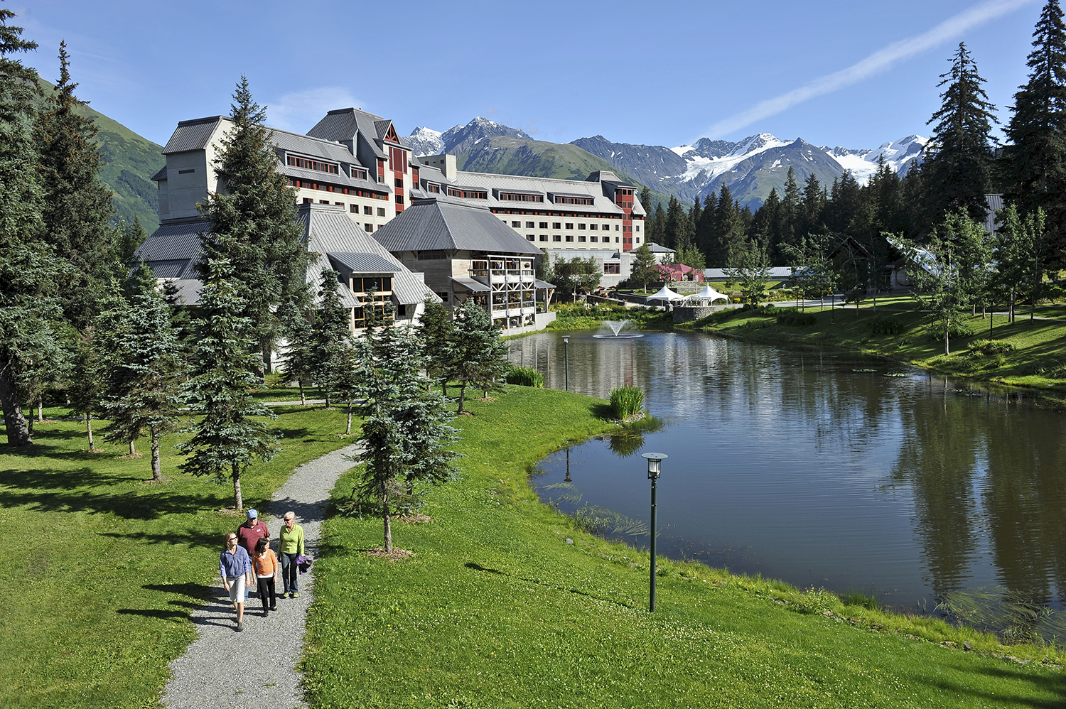 The chateau-style hotel is set in a lush valley surrounded by mountain peaks, hanging glaciers and ocean views.