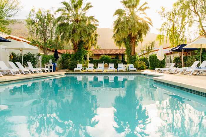 View of the swimming pool at Alcazar in Palm Springs. [Image courtesy of Palm Springs Preferred Small Hotels]