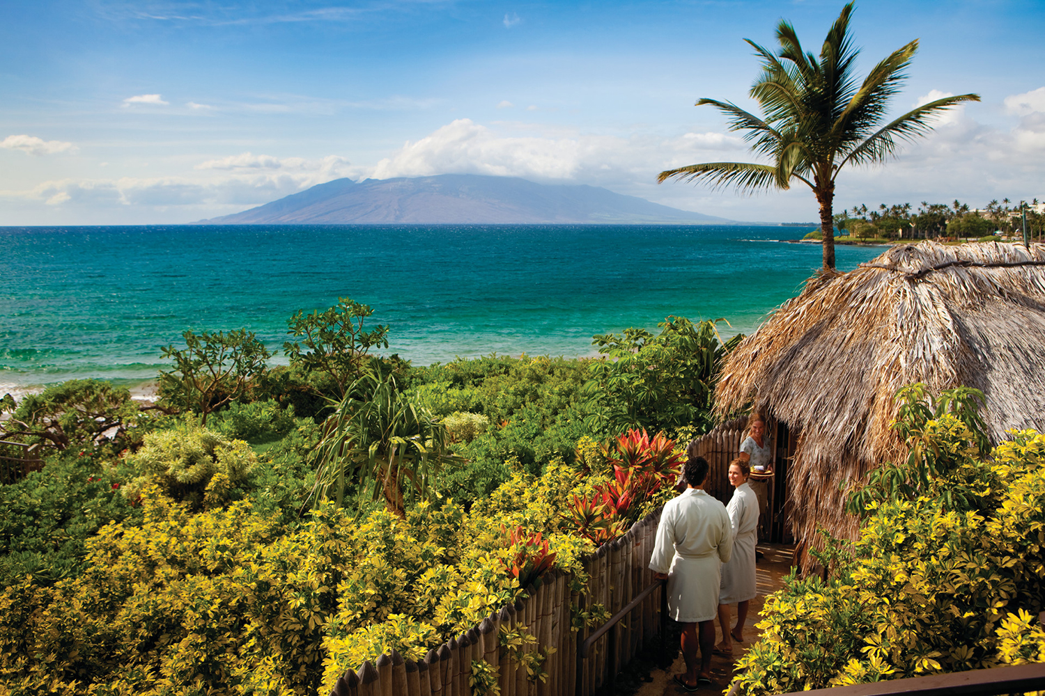 The Spa at Four Seasons Resort Maui at Wailea has oceanside hales (thatched huts). [Image courtesy of Four Seasons Resort Maui]