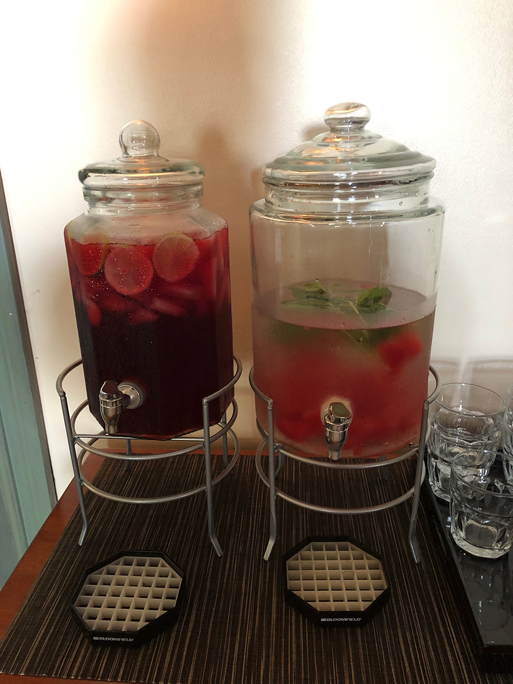 Drinks offered include pomegranate tea and watermelon-infused water.
