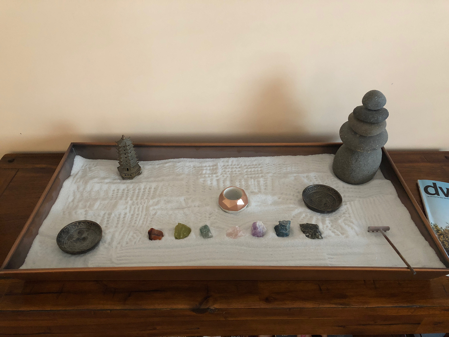 The lounge has a mini Zen sand garden that guests can play with for the purpose of relaxation.