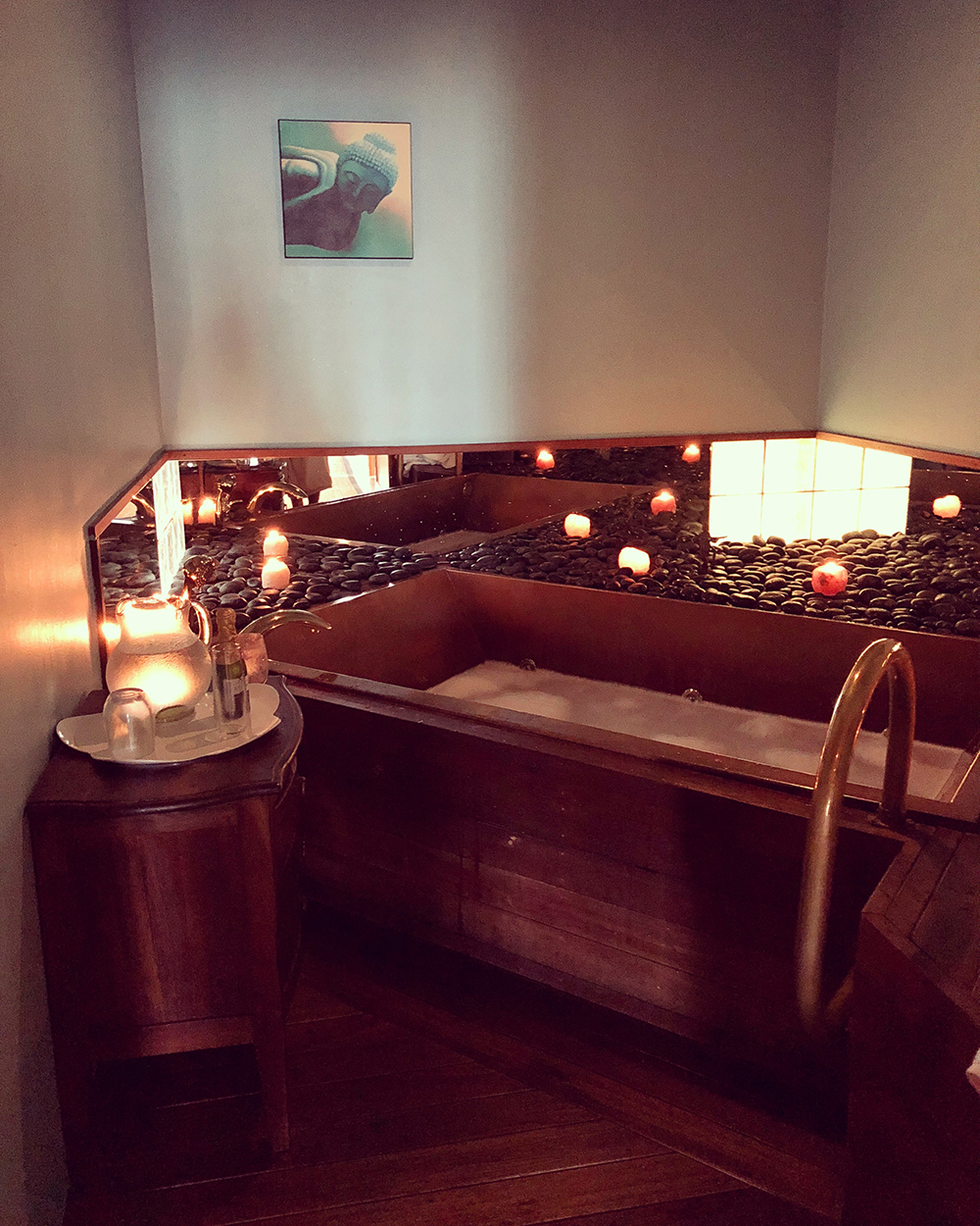 The spa's copper bathtub offers guests a variety of luxurious bath experiences to choose from.