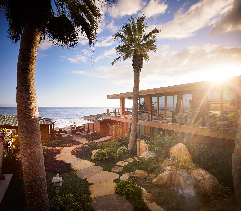 Nobu Ryokan Malibu opens onto a serene ocean-facing courtyard with a lush garden.