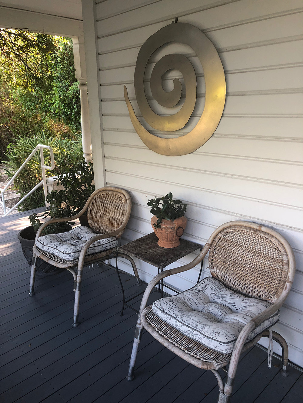 The wide, wrap-around porch offers additional comfortable seating for guests.