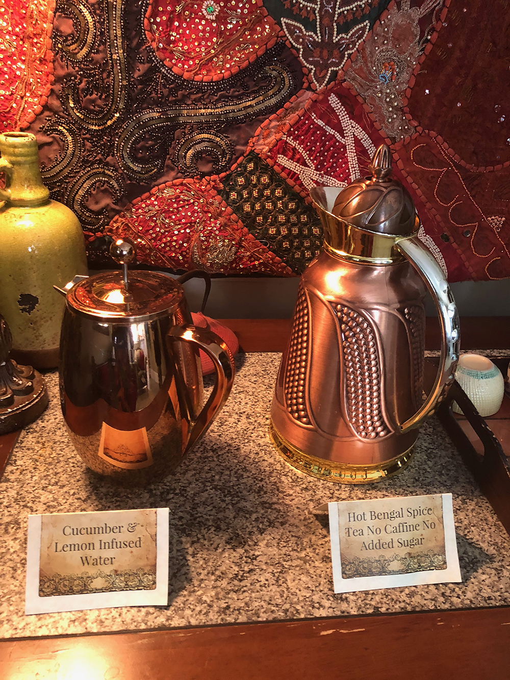 Guests are offered a choice of refreshing cucumber and lemon-infused water or hot Bengal spice tea.