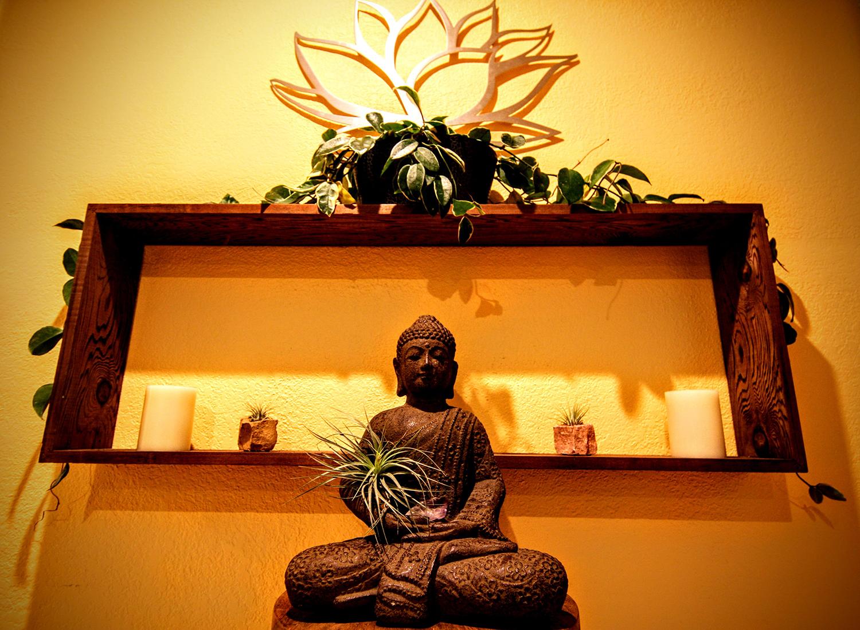 A buddha greets guests at check-in.