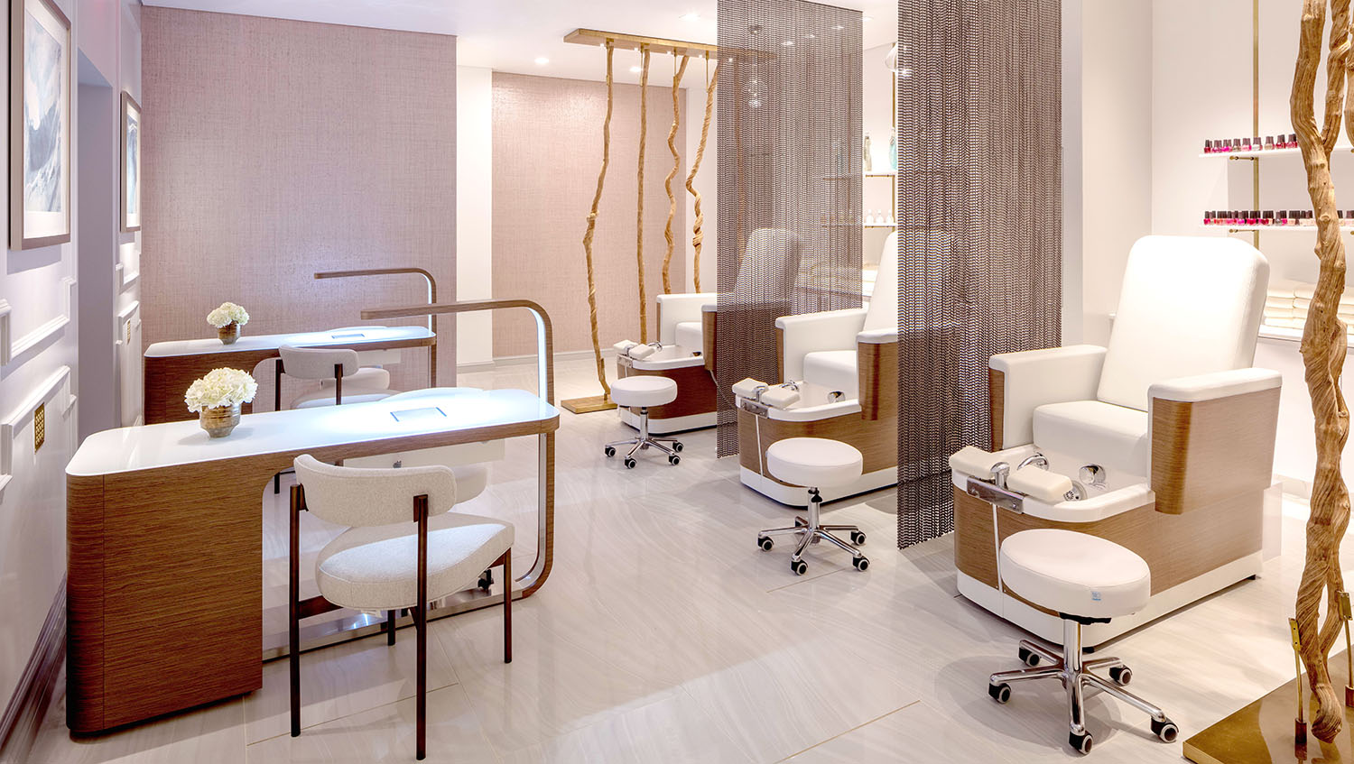 The nail salon offers multiple mani and pedi stations.