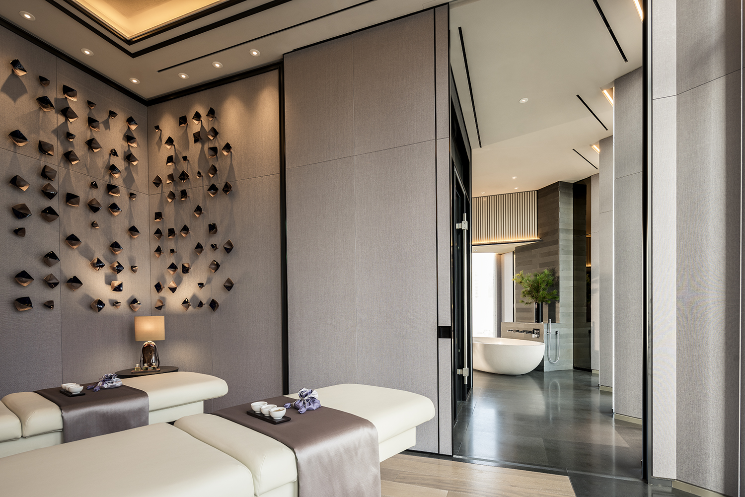 The couples' spa suite includes a large bathtub, steam room, dressing room, powder room and spacious relaxation area.