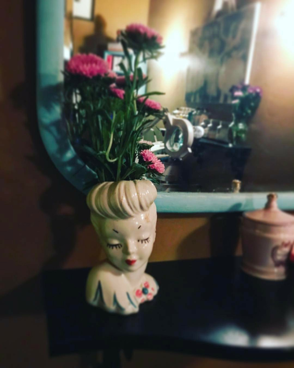 Various vintage items add a charming touch to the studio's decor.