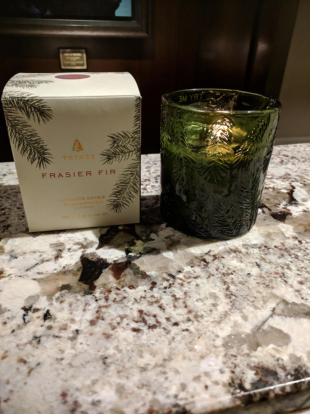 A Thyme's Frasier Fir candle burns at the front desk, creating the perfect ambiance.