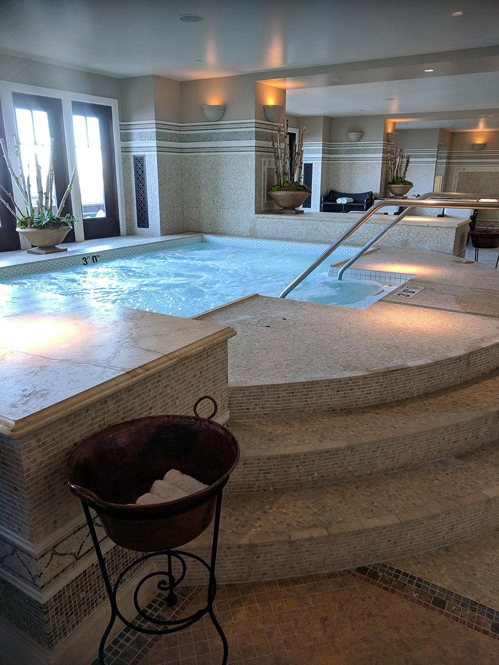 The whirlpool also features a stunning mosaic design.