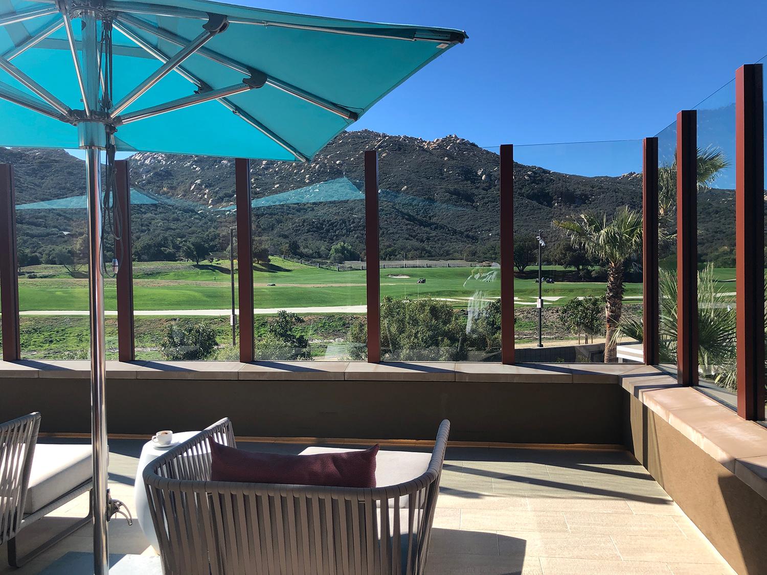The Spa lounge includes an upper outside deck that offers views of the golf course and Pu'eska Mountain.