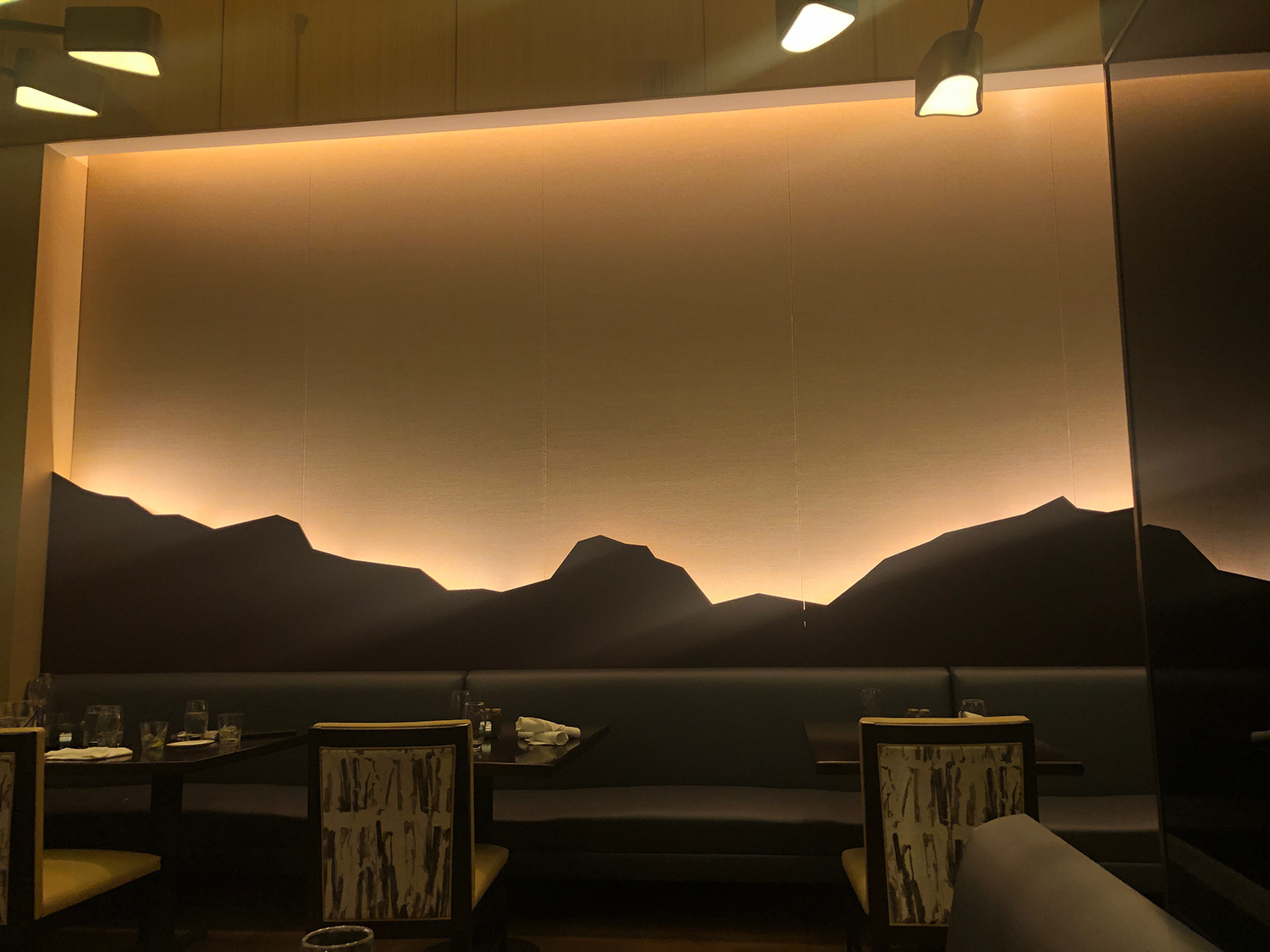 A beautiful sunset motif is part of the decor at the Resort's Lobby Bar & Grill.