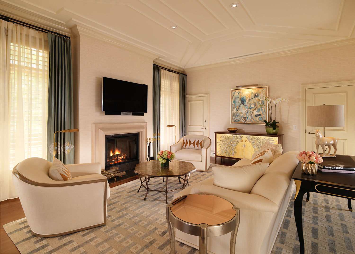The chic living room with fireplace.