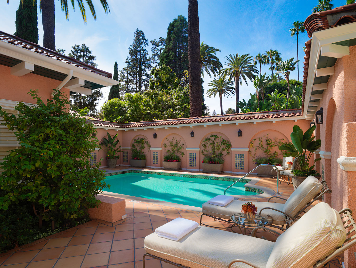 The bungalow includes a private outdoor pool, Jacuzzi, and large patio with outdoor seating.