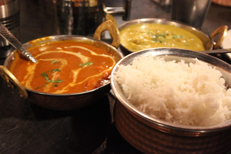 Mouthwatering tikka masala, coconut curry, and basmati rice at Saffron Colonial.
