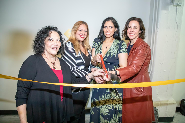 Desuar Spa owner Deisy Suarez-Giles (second from right) cuts the ribbon, accompanied by from L to R: Patti Berman, Joella Hopkins, and Blair Besten. [Photo courtesy of Desuar Spa]