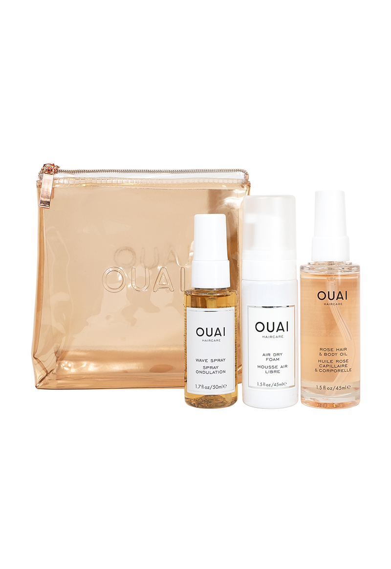 The travel-friendly kit includes Air Dry Foam, Rose Hair & Body Oil, and Wave Spray in a rose gold bag.