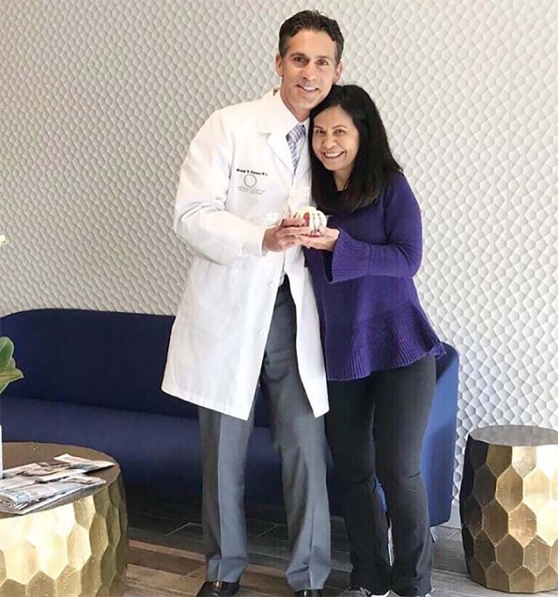 Dr newman with patient.jpg