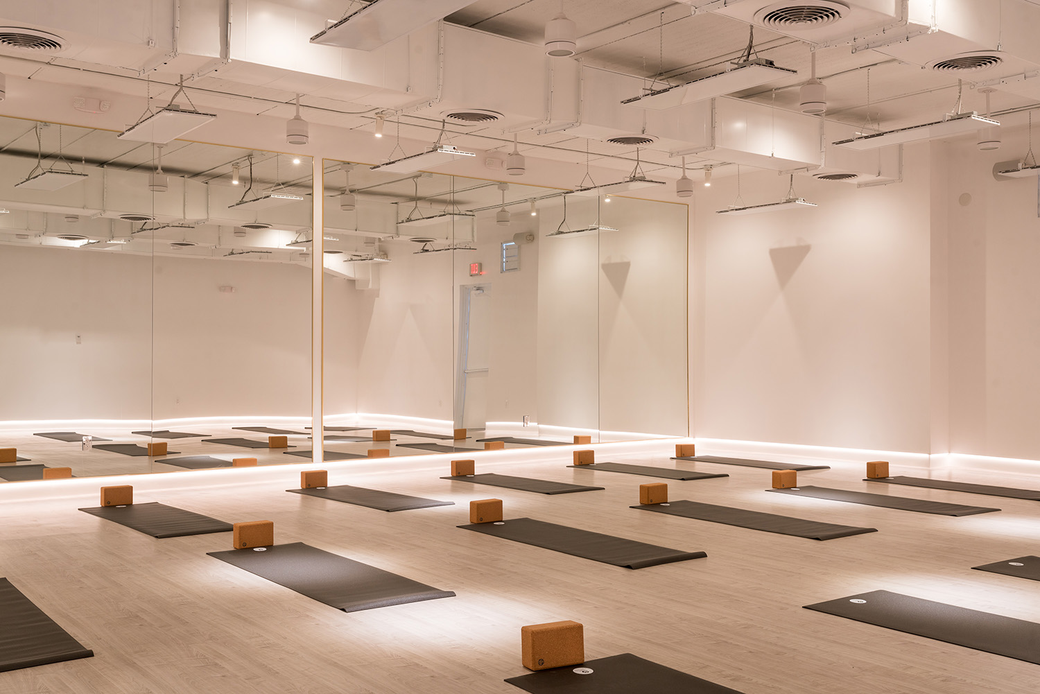 The completely renovated space includes two infrared-heated yoga and workout studios, and offers yoga classes for all levels and backgrounds.