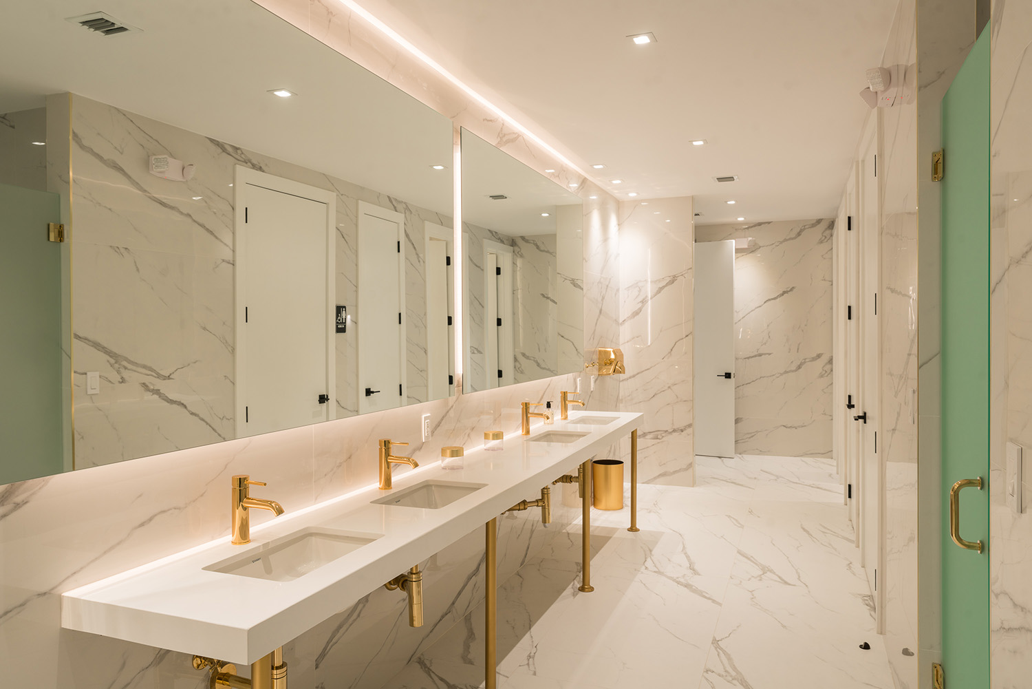 Luxe amenities include marbled restrooms, showers and lockers.